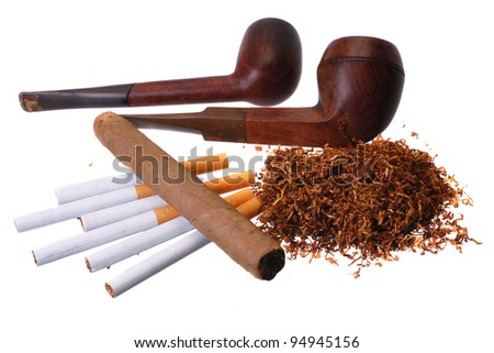 Tobacco. Cigar, cigarettes, pipes and a handfull of tobacco - stock photo