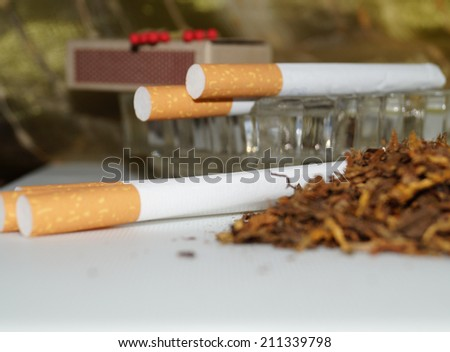 tobacco for making cigarettes - cigarettes - a habit - stock photo