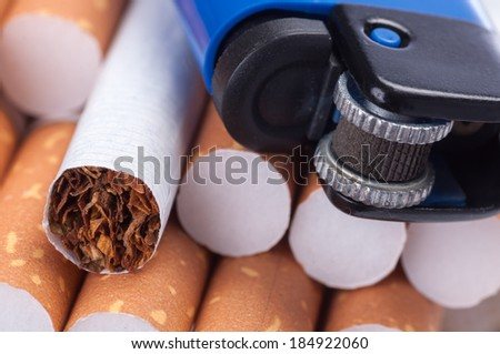 Tobacco in cigarettes and lighter close up