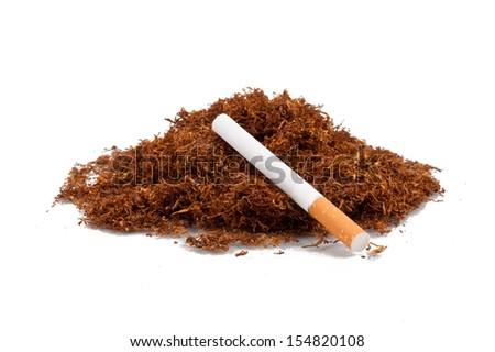 Tobacco pile and cigarette - stock photo