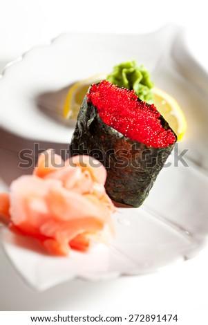 Tobiko Gunkan Sushi Garnished with Ginger and Wasabi - stock photo