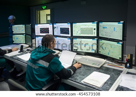 Tobolsk, Russia - July 15. 2016: Sibur company. Central control panel of Tobolsk Polymer plant. The engineering personnel watch in monitors work of the equipment - stock photo