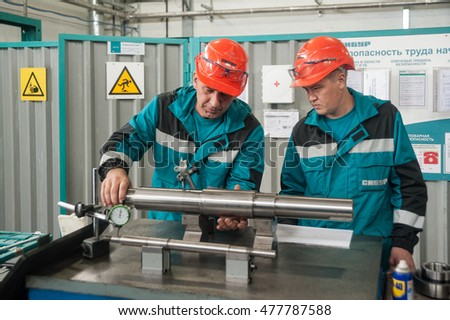 Tobolsk, Russia - July 15. 2016: Sibur company. Polymer plant. Mechanics carry out adjusting in the workshop