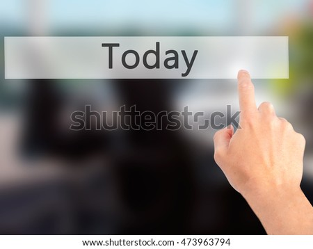 Today - Hand pressing a button on blurred background concept . Business, technology, internet concept. Stock Photo