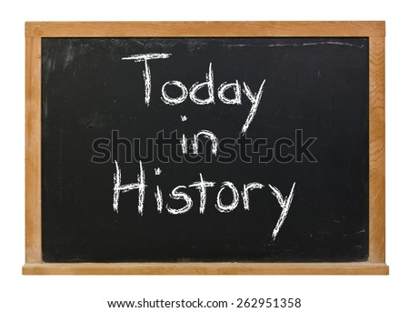 Today in history written in white chalk on a black chalkboard isolated on white - stock photo