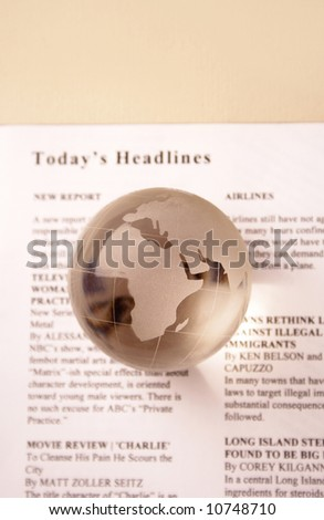 today's headlines. global news. newspaper and globe - stock photo
