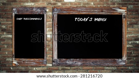 Today's menu and Chef recommends on vintage chalk board over brick wall background - stock photo
