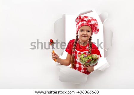 Today's menu - little girl presenting vegetable salad - with copy space