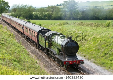 TODDINGTON, UK - MAY 27: Ex LNER B12 steam locomotive 8572 gives pleasure trips to paying  passengers on an old preserved railway line on May 27, 2013 in Toddington - stock photo