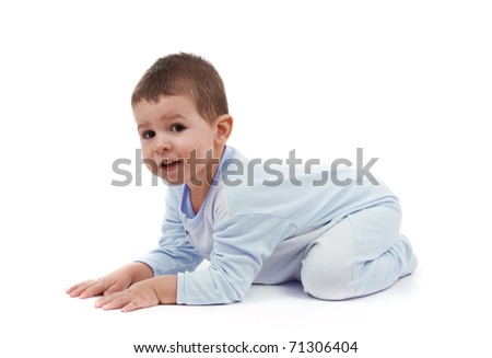Toddle in pajamas all fours, isolated on white
