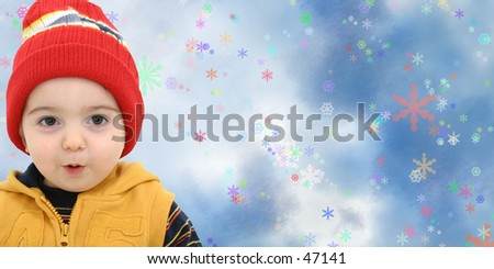 Toddler boy against a magical snow storm with space for copy. - stock photo