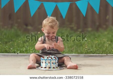 Toddler boy and Cake Smash - stock photo