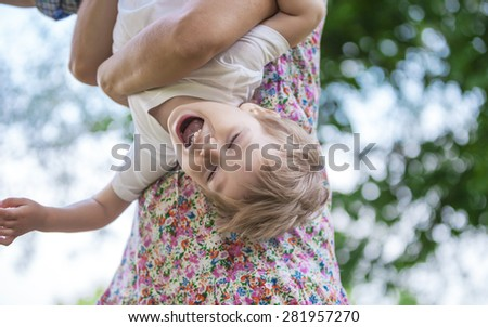 Toddler boy and his mom having fun in summer park - stock photo
