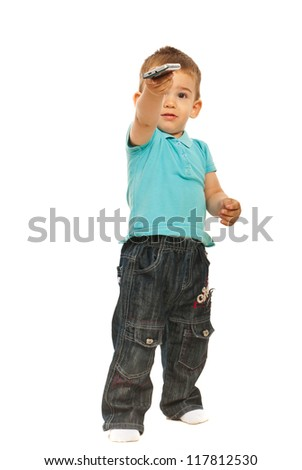 Toddler boy giving phone mobile isolated on white background - stock photo