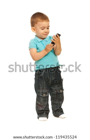Toddler boy holding a cellphone isolated on white background - stock photo