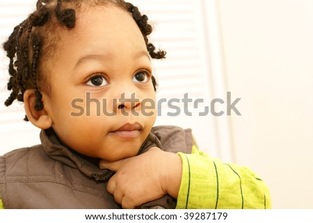 toddler boy in contemplation - stock photo