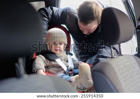 Toddler boy in the car seat - stock photo