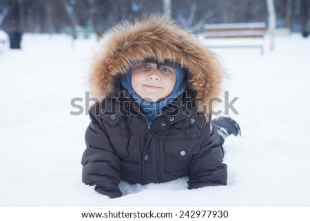 toddler boy in the snow - stock photo