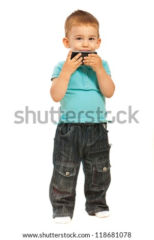 Toddler boy kissing a cell phone isolated on white background - stock photo