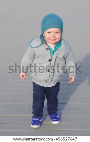 toddler boy shivering cold and smiling