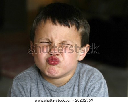 toddler boy with scrunched up face - stock photo