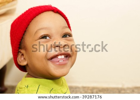 toddler boy with smiling with red toque