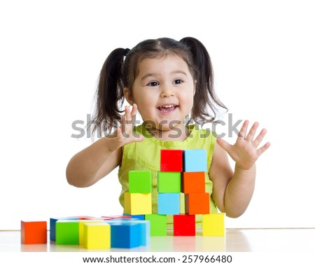 toddler child girl playing wooden toy blocks isolated - stock photo