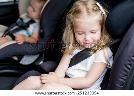 Toddler cute kids in car seats summer - stock photo