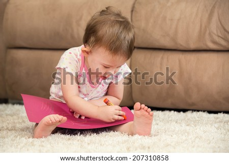 Toddler drawing in Living Room - stock photo