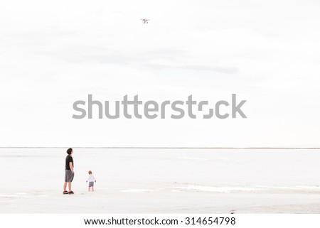 Toddler girl playing at Bonneville Salt Flats. - stock photo