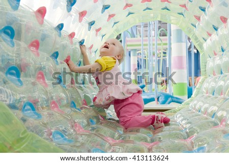 Toddler girl portrait playing in the playroom - stock photo