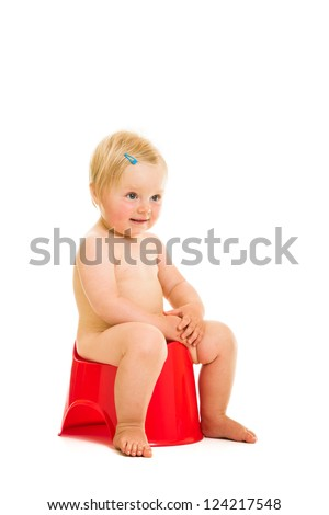 Toddler girl potty trainting isolated on white - stock photo