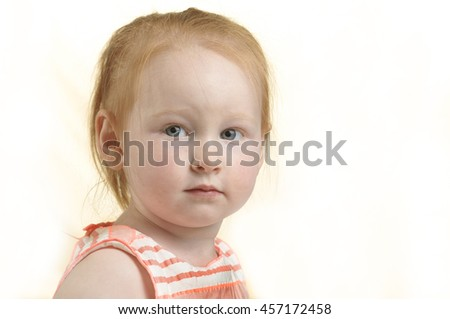 Toddler girl with a pensive look isolated on white background