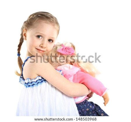 toddler girl with doll - stock photo