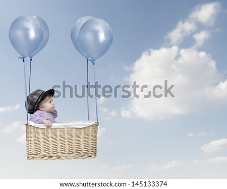 Toddler in a hot-air balloon, flying in the air