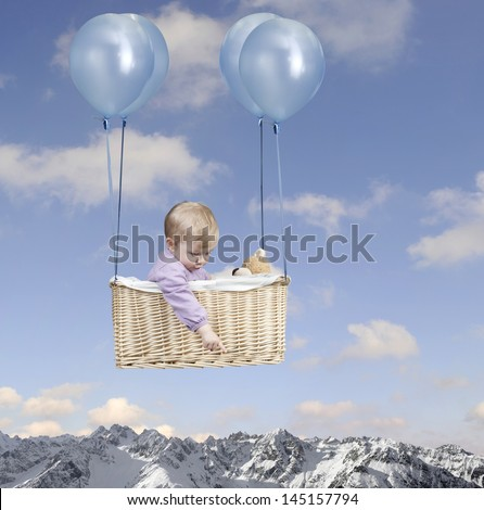 Toddler in a hot air balloon, flying in the air