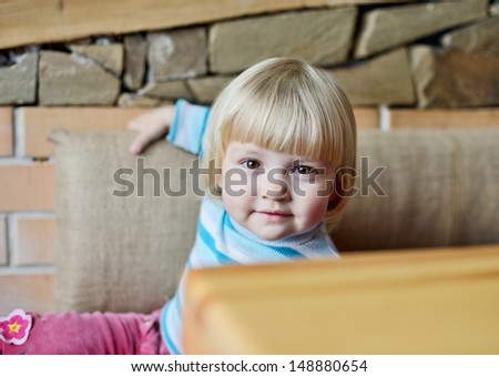 toddler in cafe sitting near the table - stock photo