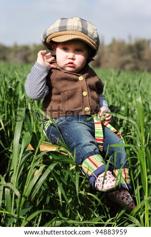 toddler in the green grass