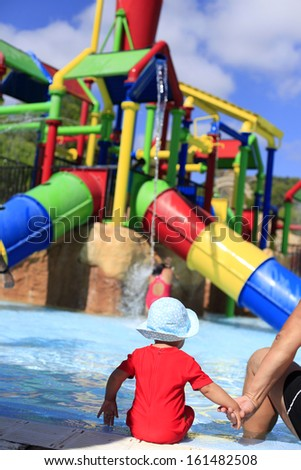 Toddler in water park - stock photo