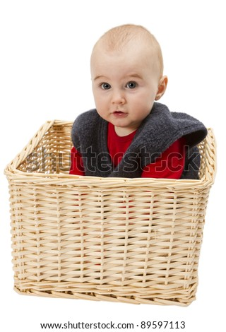 toddler in wicker-basket isolated on white background