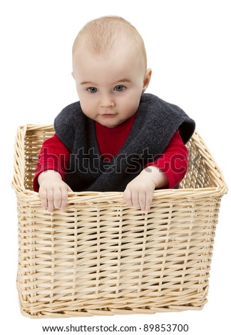 toddler in wicker basket isolated on white background