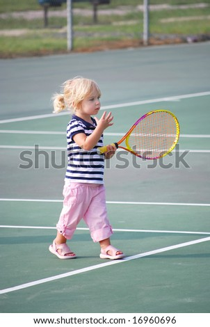 toddler learning tennis - stock photo