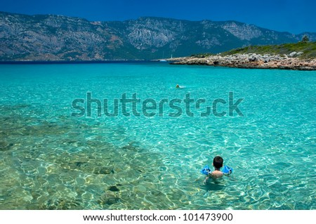 Toddler looking at the sea - stock photo