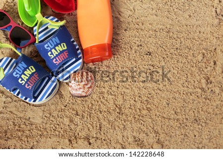 Toddler must-have on beach - stock photo