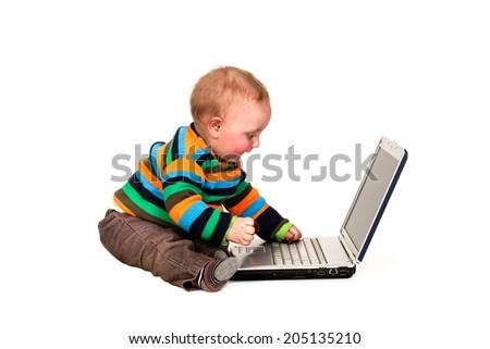 toddler playing on laptop - stock photo