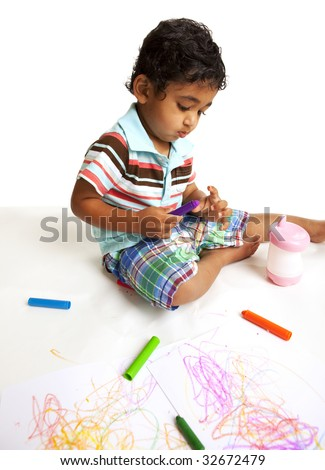 Toddler Playing with Crayons on White - stock photo