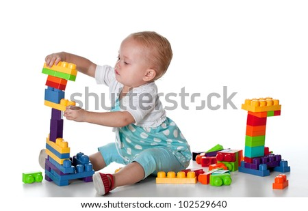toddler playing with educational blocks - stock photo