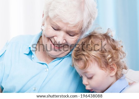 Toddler spending free time with grandma, horizontal - stock photo