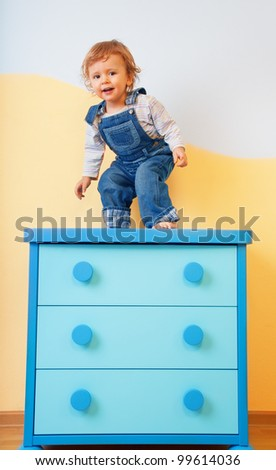 Toddler standing and jumping from furniture