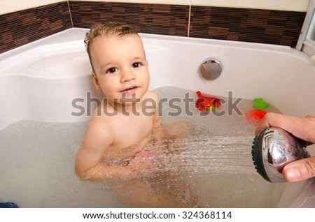 Toddler Taking A Bath Little Baby In Bathtub Mothers Hand Washing His Hair